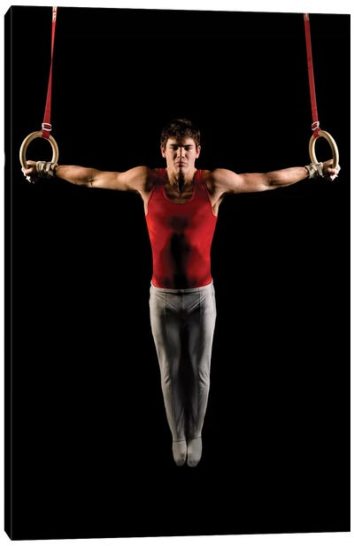 Young man exercising on gymnastic rings, Bainbridge Island, Washington State, USA Canvas Art Print