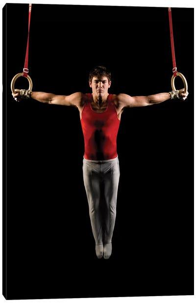 Young man exercising on gymnastic rings, Bainbridge Island, Washington State, USA Canvas Art Print