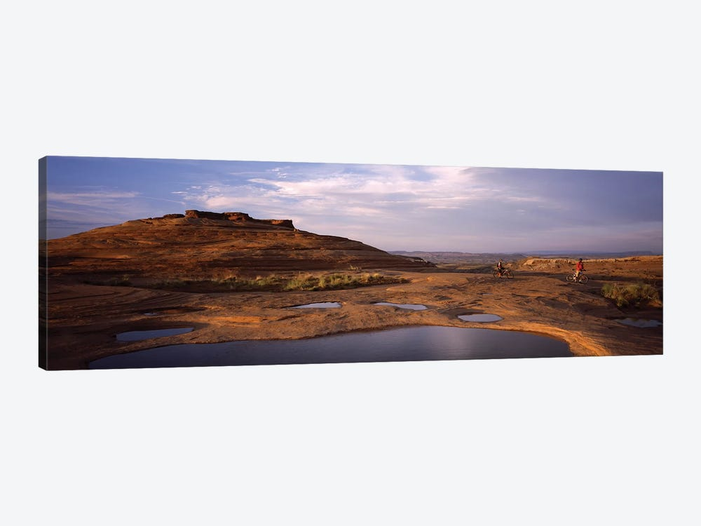 Mountain bike riders on a trail, Slickrock Trail, Sand Flats Recreation Area, Moab, Utah, USA by Panoramic Images 1-piece Art Print