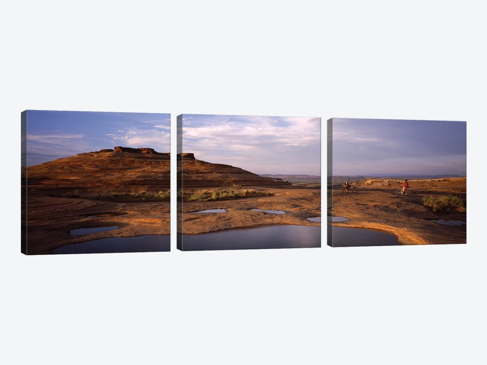 Mountain bike riders on a trail, Slickrock Trail, Sand Flats Recreation Area, Moab, Utah, USA by Panoramic Images 3-piece Canvas Print