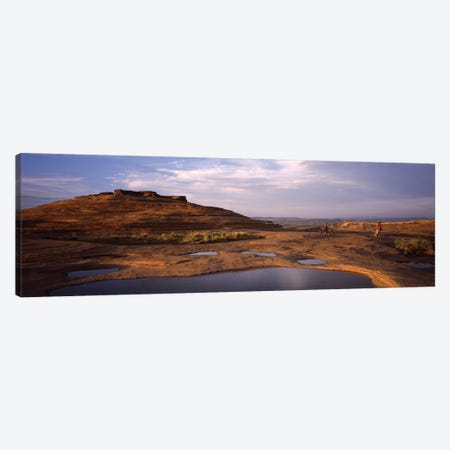 Mountain bike riders on a trail, Slickrock Trail, Sand Flats Recreation Area, Moab, Utah, USA Canvas Print #PIM12545} by Panoramic Images Art Print