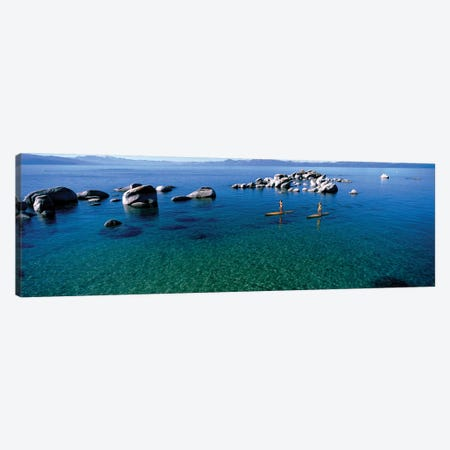 Two women paddle boarding in a lake 2, Lake Tahoe, California, USA Canvas Print #PIM12655} by Panoramic Images Canvas Print
