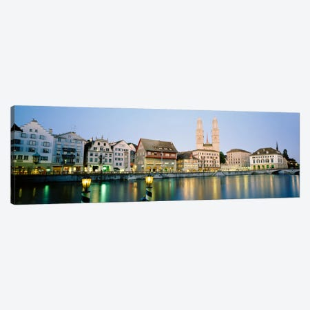 Riverfront Architecture At Twilight Featuring Grossmunster, Limmat River, Zurich, Switzerland Canvas Print #PIM129} by Panoramic Images Art Print