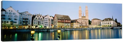 Riverfront Architecture At Twilight Featuring Grossmunster, Limmat River, Zurich, Switzerland Canvas Art Print