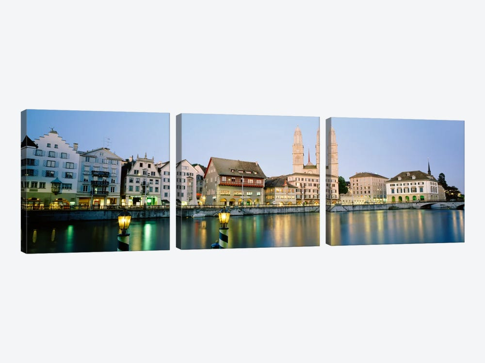 Riverfront Architecture At Twilight Featuring Grossmunster, Limmat River, Zurich, Switzerland by Panoramic Images 3-piece Canvas Art