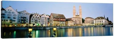 Riverfront Architecture At Twilight Featuring Grossmunster, Limmat River, Zurich, Switzerland Canvas Art Print