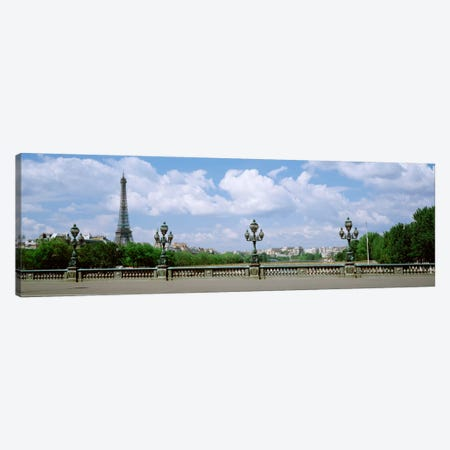 Cloudy View Of The Eiffel Tower As Seen From Pont Alexandre III, Paris, Ile-de-France, France Canvas Print #PIM1327} by Panoramic Images Canvas Art Print