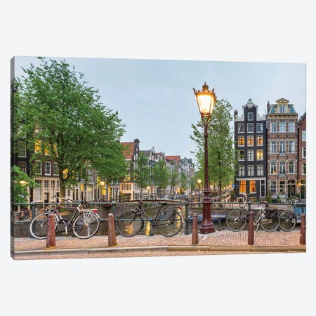 Bikes And Houses Along Canal At Dusk, Amsterdam, North Holland Canvas Print #PIM14289} by Panoramic Images Canvas Print