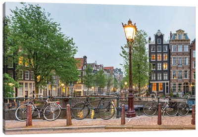 Bikes And Houses Along Canal At Dusk, Amsterdam, North Holland Canvas Art Print