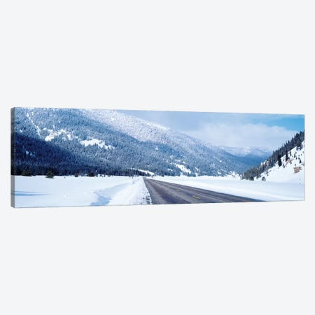Road Passing Through A Snow Covered Landscape, Yellowstone National Park, Wyoming, USA Canvas Print #PIM14844} by Panoramic Images Canvas Art