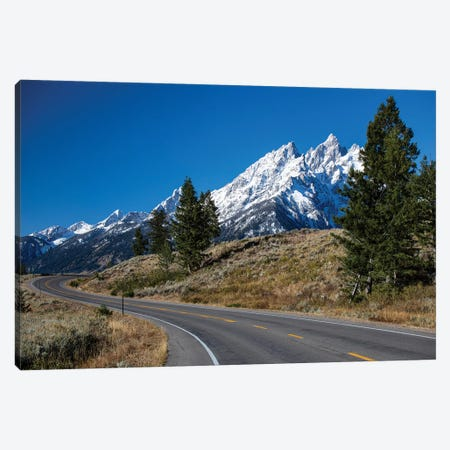 Road With Mountain Range In The Background, Teton Range, Grand Teton National Park, Wyoming, USA Canvas Print #PIM14847} by Panoramic Images Canvas Artwork