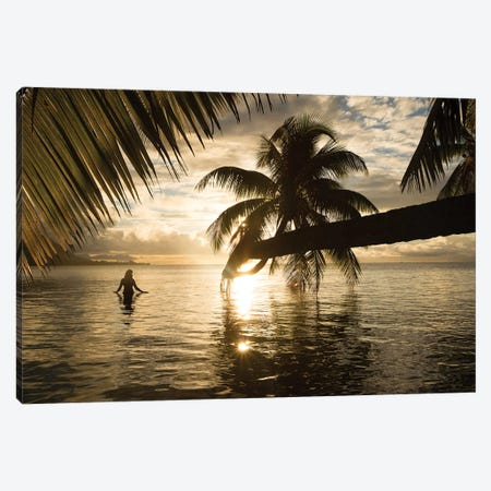 Woman Standing In The Pacific Ocean At Sunset, Moorea, Tahiti, French Polynesia I Canvas Print #PIM15068} by Panoramic Images Canvas Artwork