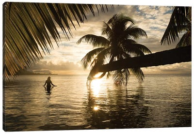 Woman Standing In The Pacific Ocean At Sunset, Moorea, Tahiti, French Polynesia I Canvas Art Print