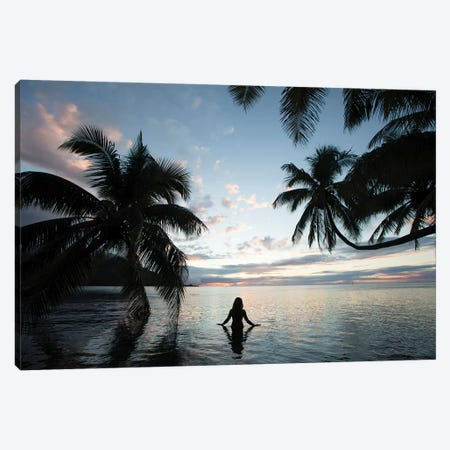Woman Standing In The Pacific Ocean At Sunset, Moorea, Tahiti, French Polynesia III Canvas Print #PIM15070} by Panoramic Images Canvas Art Print