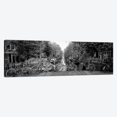 Bicycles On Bridge Over Canal, Amsterdam, Netherlands Canvas Print #PIM15083} by Panoramic Images Canvas Artwork