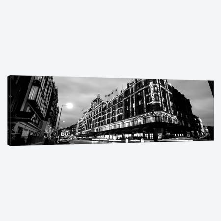 Low-Angle View Of Buildings Lit Up At Night, Harrods, London, England Canvas Print #PIM15178} by Panoramic Images Canvas Art