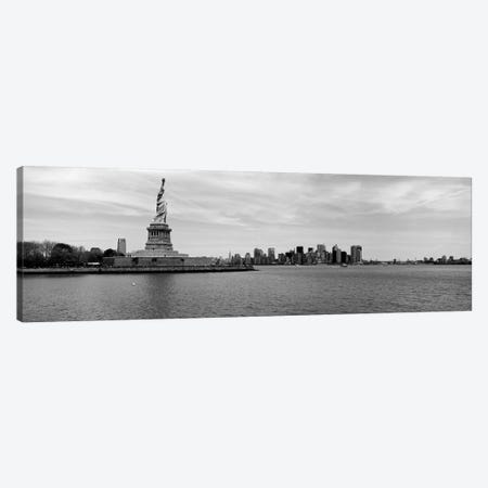 Statue Of Liberty With Manhattan Skyline In The Background, Ellis Island, New York City, New York State, USA Canvas Print #PIM15237} by Panoramic Images Canvas Art