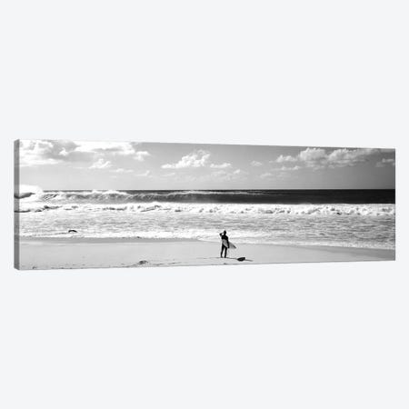 Surfer Standing On The Beach, North Shore, Oahu, Hawaii, USA Canvas Print #PIM15243} by Panoramic Images Canvas Artwork