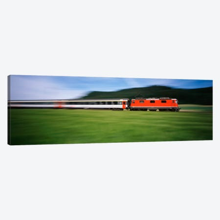 Train moving on a railroad track Canvas Print #PIM1535} by Panoramic Images Canvas Art