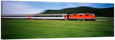 Train moving on a railroad track Canvas Art Print