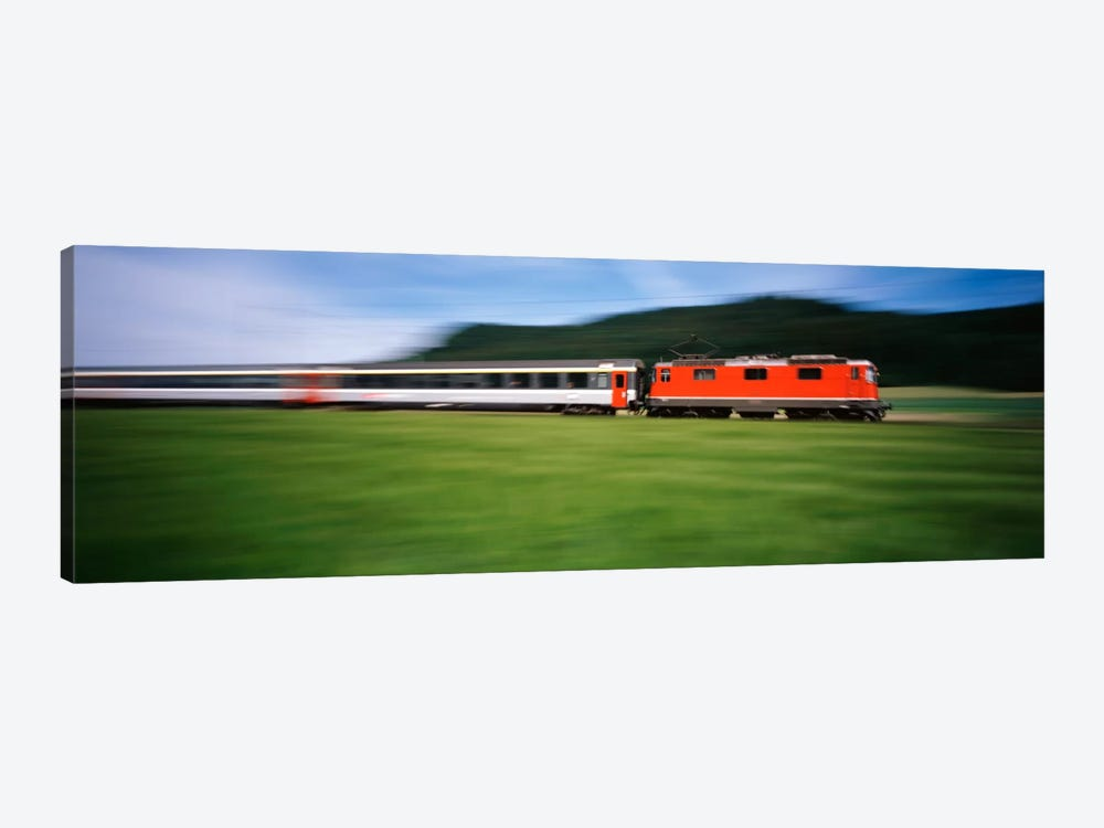 Train moving on a railroad track by Panoramic Images 1-piece Canvas Wall Art