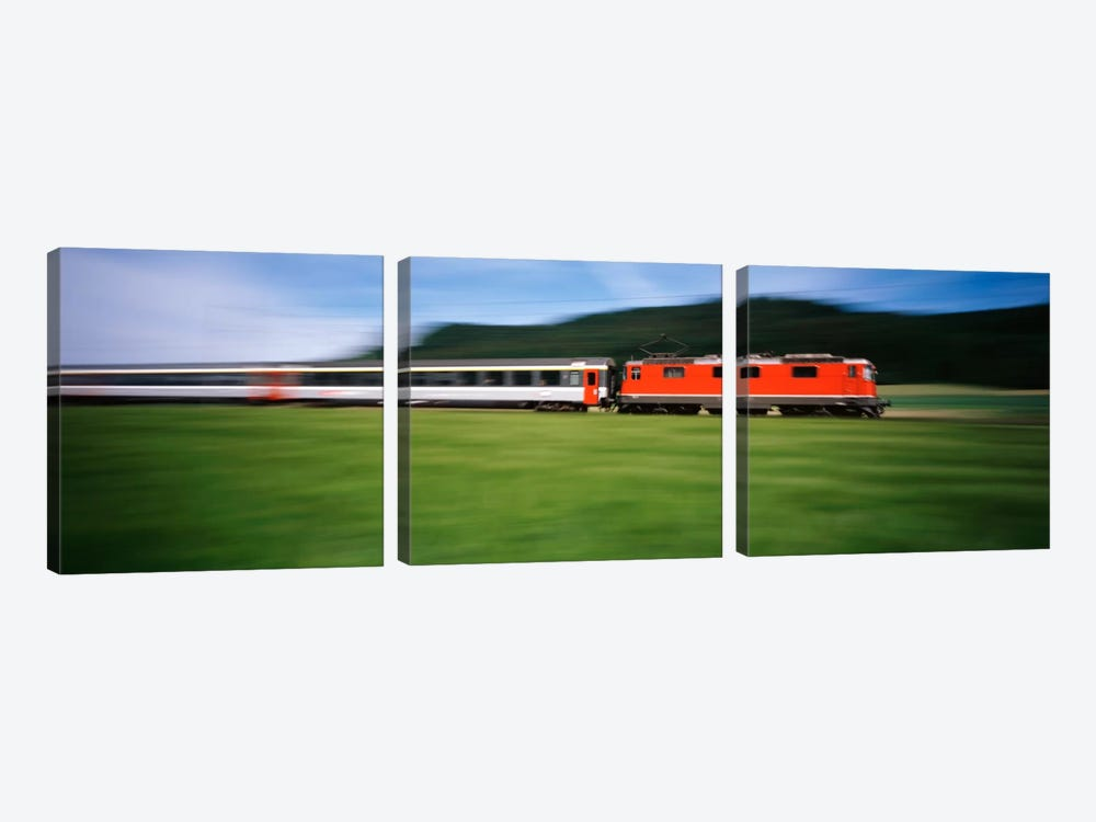 Train moving on a railroad track by Panoramic Images 3-piece Canvas Art