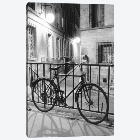Bicycle against railing, Paris, France Canvas Print #PIM15381} by Panoramic Images Art Print