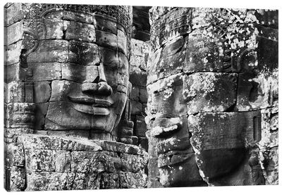 Carved stone faces in the Khmer temple of Bayon, Siem Reap, Cambodia Canvas Art Print