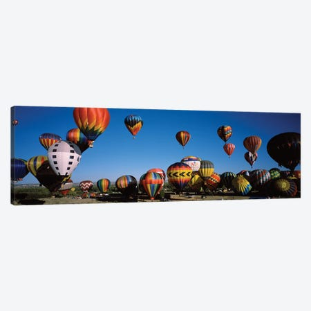 Hot air balloons floating in sky, Albuquerque International Balloon Fiesta, Albuquerque, Bernalillo County, New Mexico, USA Canvas Print #PIM15517} by Panoramic Images Art Print