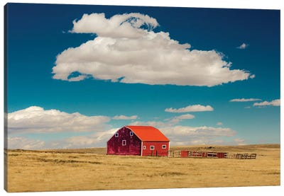 Oklahoma, USA Red barn in field with puffy clouds in remote Oklahoma Canvas Art Print