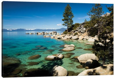 Rocks in a lake with mountain range in the background, Lake Tahoe, California, USA Canvas Art Print