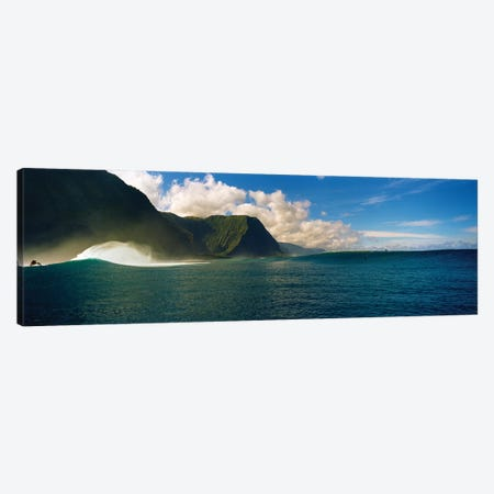 Rolling waves with mountains in the background, Molokai, Hawaii Canvas Print #PIM15706} by Panoramic Images Canvas Artwork