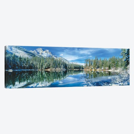 Snow covered mountain and trees reflected in lake, Grand Tetons, Wyoming, USA Canvas Print #PIM15750} by Panoramic Images Canvas Wall Art