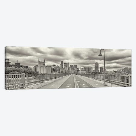 Stone Arch Bridge with buildings in the background, Mill District, Upper Midwest, Minneapolis, Hennepin County, Minnesota, USA Canvas Print #PIM15763} by Panoramic Images Canvas Art Print
