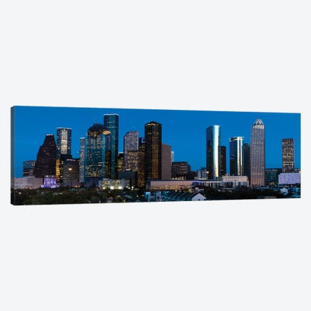 High Rise Buildings In Houston Cityscape Illuminated At Sunset, Houston, Texas Canvas Print #PIM15894} by Panoramic Images Canvas Artwork
