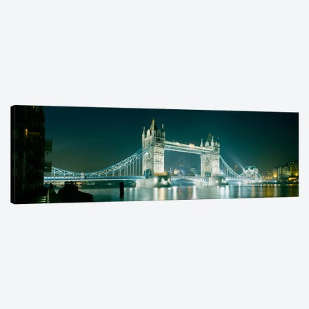 Low angle view of a bridge lit up at nightTower Bridge, London, England Canvas Print #PIM176} by Panoramic Images Art Print