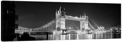 Low angle view of a bridge lit up at night, Tower Bridge, London, England (black & white) Canvas Art Print