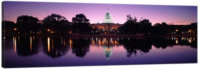 Reflection of a government building in a lakeCapitol Building, Washington DC, USA Canvas Art Print