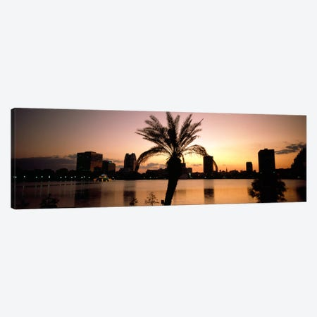 Silhouette of buildings at the waterfront, Lake Eola, Summerlin Park, Orlando, Orange County, Florida, USA Canvas Print #PIM1895} by Panoramic Images Canvas Print