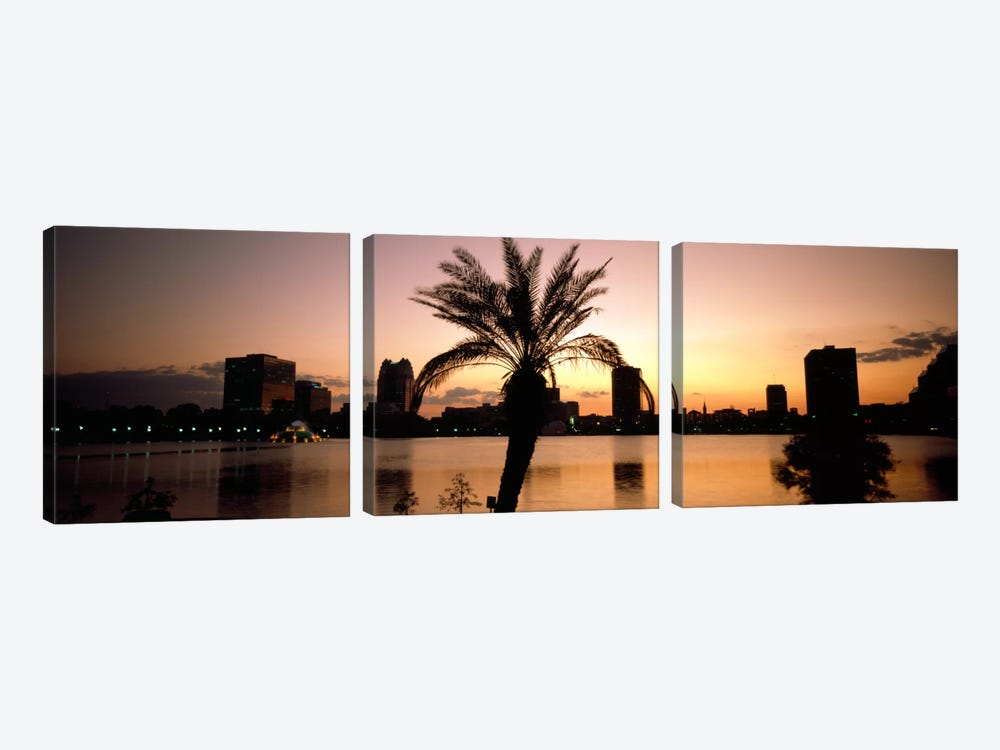 Silhouette of buildings at the waterfront, Lake Eola, Summerlin Park, Orlando, Orange County, Florida, USA by Panoramic Images 3-piece Art Print