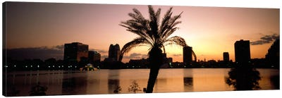 Silhouette of buildings at the waterfront, Lake Eola, Summerlin Park, Orlando, Orange County, Florida, USA Canvas Art Print