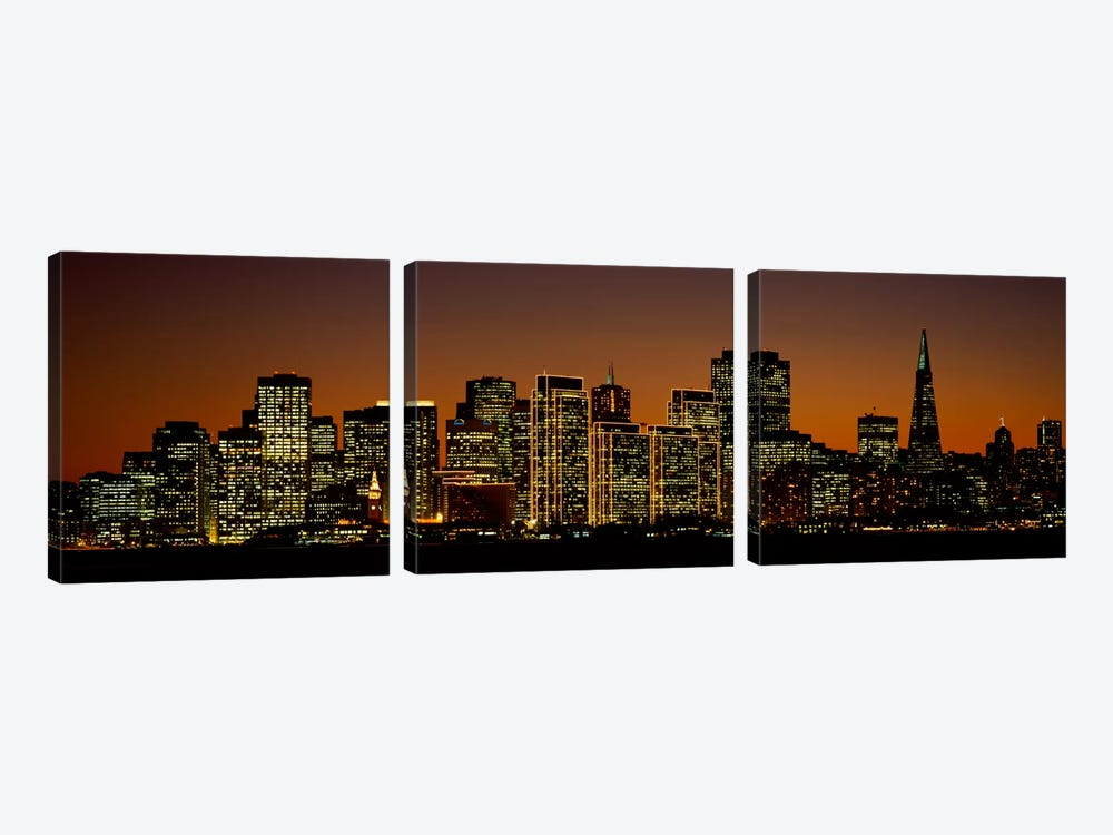 Skyscrapers lit up at nightSan Francisco, California, USA by Panoramic Images 3-piece Art Print