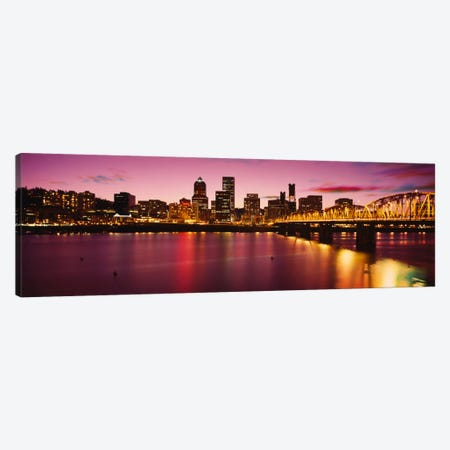 Skyscrapers lit up at sunset, Willamette River, Portland, Oregon, USA Canvas Print #PIM1936} by Panoramic Images Canvas Art