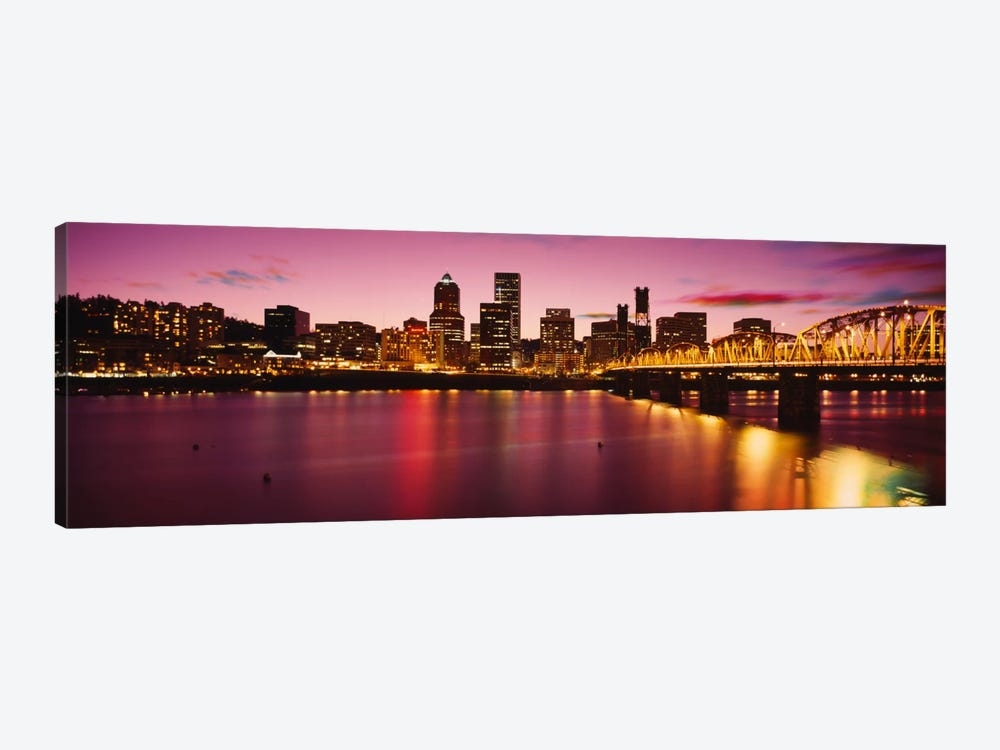Skyscrapers lit up at sunset, Willamette River, Portland, Oregon, USA by Panoramic Images 1-piece Canvas Art Print