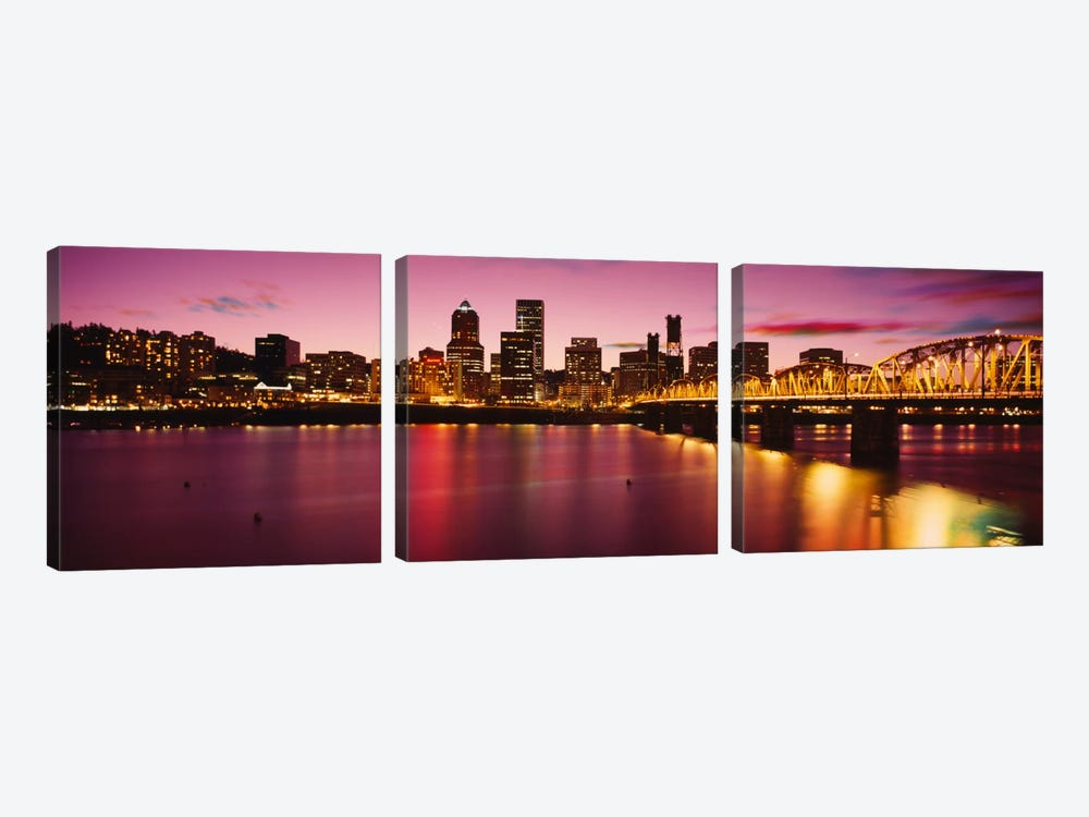 Skyscrapers lit up at sunset, Willamette River, Portland, Oregon, USA by Panoramic Images 3-piece Canvas Print