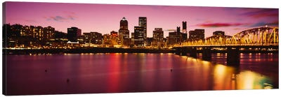 Skyscrapers lit up at sunset, Willamette River, Portland, Oregon, USA Canvas Art Print