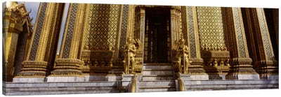 Low angle view of statues in front of a temple, Phra Mondop, Grand Palace, Bangkok, Thailand Canvas Art Print