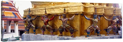 Statues at base of golden chedi, The Grand Palace, Bangkok, Thailand Canvas Art Print
