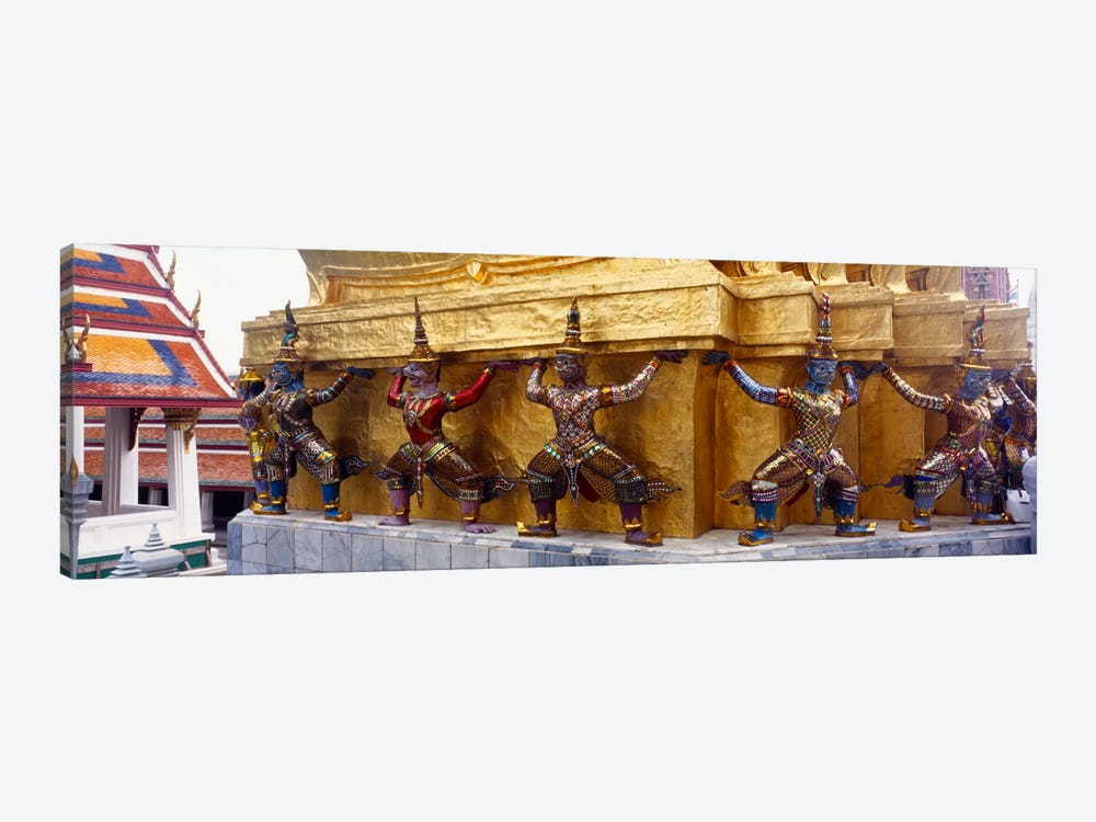 Statues at base of golden chedi, The Grand Palace, Bangkok, Thailand 1-piece Canvas Print