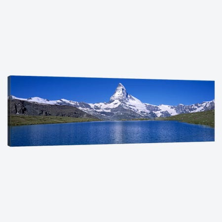 A Snow Covered Matterhorn With Reffelsee In The Foreground, Valais, Switzerland Canvas Print #PIM2106} by Panoramic Images Canvas Print